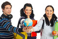 Students with hands together holding globe Royalty Free Stock Photo