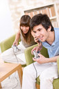 Students - happy teenagers playing video game Stock Images
