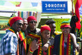 Students in knitted caps and scarfs in national et people scarf of ethiopian flag colours at the international festival moscow may Stock Photography