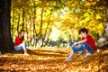 Students learning outdoor girl and boy reading book in park Royalty Free Stock Photography