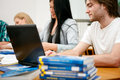Students learning together in class in university Stock Image