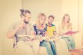 Students learning together group of reading books four friends before examination vintage style look Stock Photos