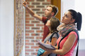 Students looking at notice board Royalty Free Stock Photo