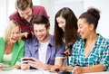 Students looking at smartphone at school education technology and internet smiling Stock Images
