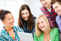 Students looking at tablet pc in lecture at school education and internet smiling Stock Images