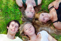 Students lying on grass Stock Images