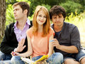 Students at outdoor doing homework. Stock Images