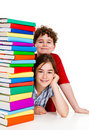 Students and pile of books Stock Photos