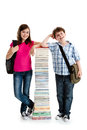 Students and pile of books Royalty Free Stock Photos