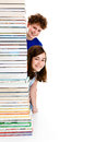 Students and pile of books Stock Photo