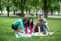 Students play a game in the park twister beautiful indoor little happy kindergarten Royalty Free Stock Photos