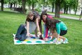 Students play the game twister a in park Stock Images