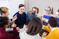Students playing guess-who game Royalty Free Stock Photo