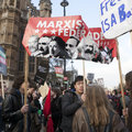 Students protest against fees and cuts and debt in central London.