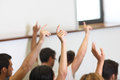 Students put hand up in class room want to answer the question asked by the professor Royalty Free Stock Image