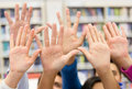 Students raising their hand Royalty Free Stock Image