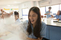 Students in science class, studying the reaction of dry ice Royalty Free Stock Photo