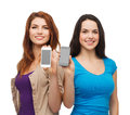 Students showing blank smartphones screens education and modern technology concept smiling Stock Images
