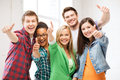 Students showing thumbs up at school education concept happy team of Stock Photography