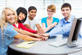 Students showing unity with their hands together international group of Royalty Free Stock Photography