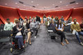 Students sit facing camera in a modern university classroom Royalty Free Stock Photo