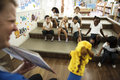 Students sitting on the floor listening to story Royalty Free Stock Photo