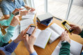 Students with smartphones making cheat sheets people education technology and exam concept close up of taking picture of books Stock Photo