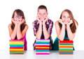 Students with stacked books smiling colorful Royalty Free Stock Image