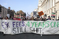 Students take part in a protest march against fees london england november and cuts the education system on november london Stock Image