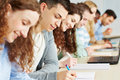 Students taking exam seminar university Stock Image