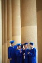 Students talking group of smart in graduation gowns having chat Royalty Free Stock Photo