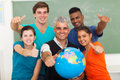 Students teacher classroom group of high school geography and senior giving thumbs up in Stock Image