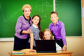 Students and teacher a her during class at school education Royalty Free Stock Photo