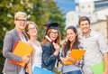 Students or teenagers with files and diploma education campus teenage concept group of folders eyeglasses Royalty Free Stock Image
