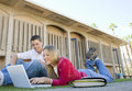 Students using laptop on college campus happy young men and women Royalty Free Stock Photo