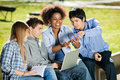 Students with using mobilephone in university happy young campus Royalty Free Stock Photo