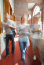 Students walking through hallway toward camera in school Royalty Free Stock Photos