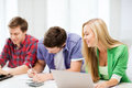 Students writing test or exam in lecture at school education and internet smiling Royalty Free Stock Photography
