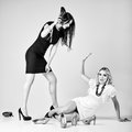 Studio fashion shot battle of two beautiful women blonde and brunette the black white Stock Photography
