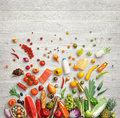 Studio photo of different fruits and vegetables on wooden table. Royalty Free Stock Photo