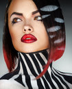 Studio photo of fashion model with stripes on body and hair Royalty Free Stock Photo