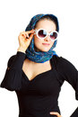 Studio photo of the woman in sunglasses and a scarf on her head Stock Photography