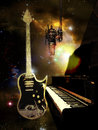 Studio piano and guitar electric in a with blur universe background Stock Image