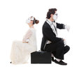 Studio picture of two mimes sitting on suitcase Royalty Free Stock Photography