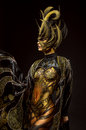 Studio portrait of beautiful model with fantasy golden butterfly body art