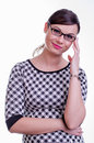 Studio portrait of a brunette secretary with glasses young beautiful woman white background isolated shiny lipstick hand at her Stock Photos