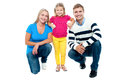 Studio portrait of charming young family Royalty Free Stock Photo
