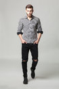 Studio portrait of handsome elegant young man in casual clothes Royalty Free Stock Photo