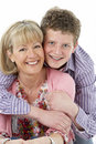 Studio Portrait of Smiling Teenage Boy with Mum Royalty Free Stock Photo