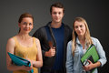 Studio portrait of three university students Royalty Free Stock Images